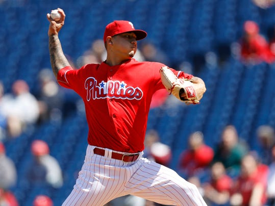 FILE - This April 14, 2016, file photo shows Philadelphia Phillies' Vince Velasquez pitching during the first inning of a baseball game against the San Diego Padres in Philadelphia. A dazzling, 16-strikeout performance was the best and worst thing that happened to Vince Velasquez last season. The hard-throwing righty quickly showed his electric stuff in his second start with the Phillies, tossing a three-hitter with no walks and 16 Ks against San Diego last April. But Velasquez spent the rest of the season trying to do it again. (AP Photo/Matt Slocum, File)