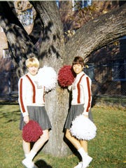 Carol St.John, left, was a member of the Wisconsin State University-La Crosse pom pom squad that had its Ice Bowl performance called off because of the cold.