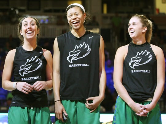 FGCU's Stephanie Haas, left, Whitney Knight and Haley Laughter greet fans recently at the Dunk City After Dark event at Alico Arena in Fort Myers.