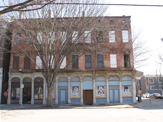 BEFORE: This building at 1500 Elm was built in 1864.