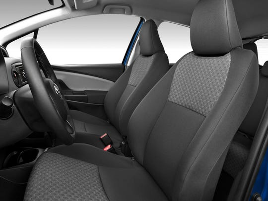The 2015 Toyota Yaris' interior has more padded materials and new upholstery.