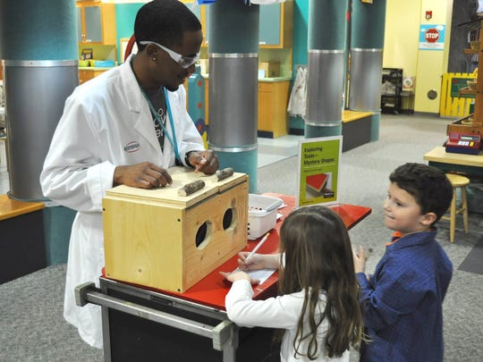 A rolling Science a la carte entertains visitors to the Discovery Center at Murfree Spring.