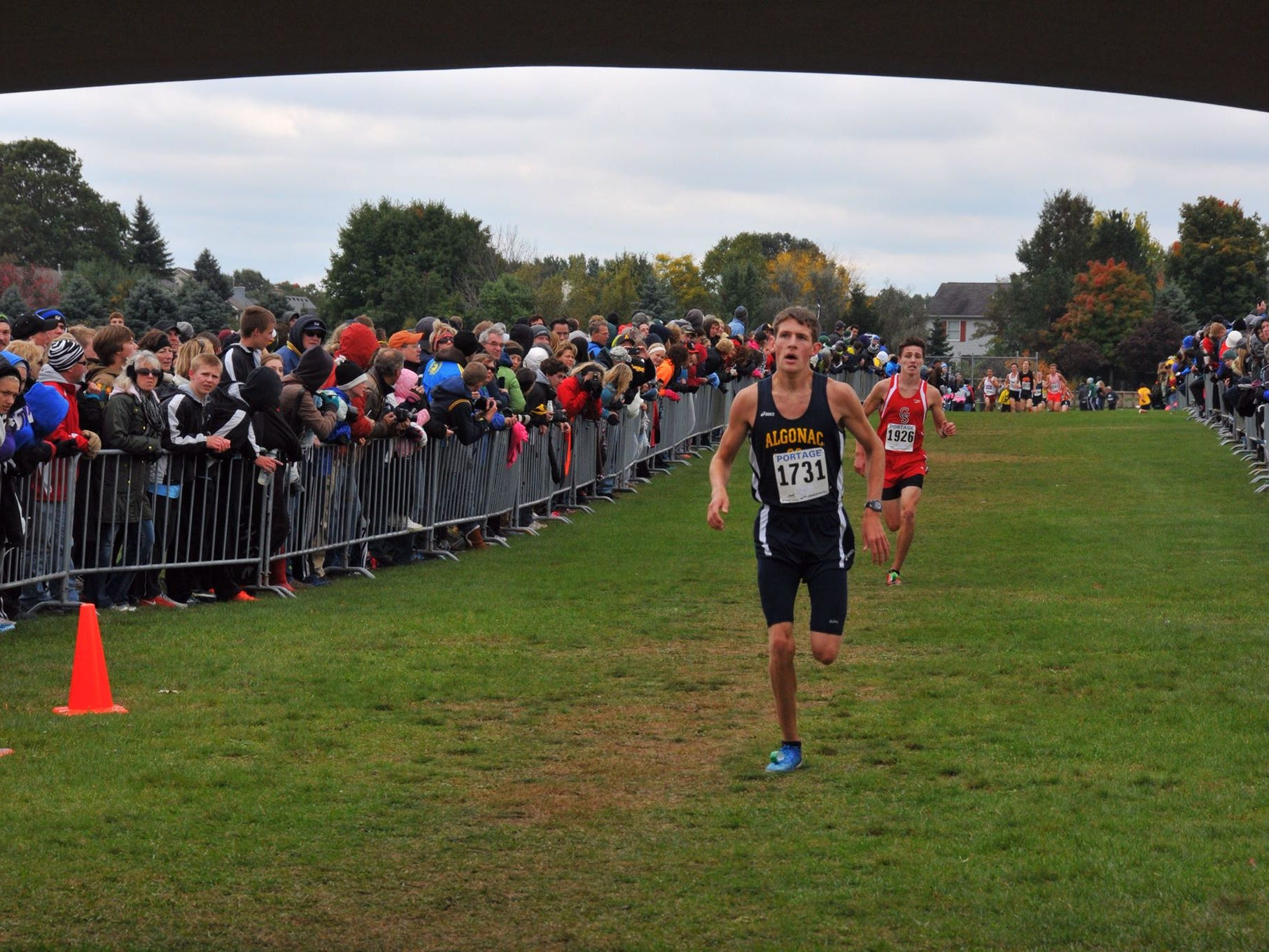 Algonac's Morgan Beadlescomb finishes in second in the division two boys race at the Portage Invitational.