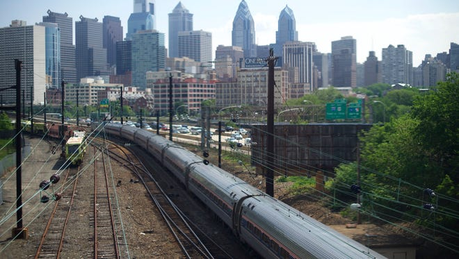 A northbound Amtrak train approaches 30th Street Station in Philadelphia on May 18, 2015.