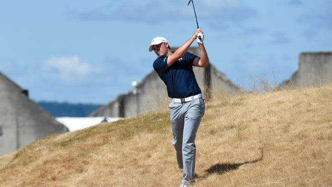 Jordan Spieth plays from the rough on the 18th hole in the second round.