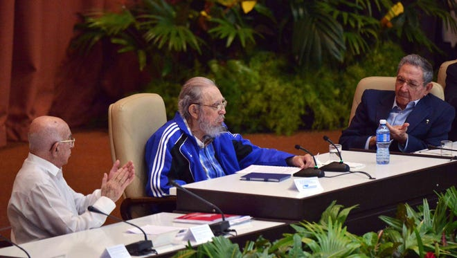 """Handout picture released by Cuban Agency ACN showing Cuban former President Fidel Castro (C) talking during the closing ceremony of the VII Congress of the Cuban Communist Party (PCC) at the Convention Palace in Havana, on April 19, 2016, as the Second Secretary of the PCC Jose Ramon Machado Ventura (R) and Cuban President Raul Castro listen. """"Cuba will never permit the application of so-called shock therapies, which are frequently applied to the detriment of society's most humble classes,"""" said Raul Castro in a lengthy speech opening the congress, which takes place every five years and will stretch on for several days.  / AFP PHOTO / ACN / OMARA GARCIA MEDEROS / RESTRICTED TO EDITORIAL USE - MANDATORY CREDIT """"AFP PHOTO / ACN / OMARA GARCIA MEDEROS"""" - NO MARKETING NO ADVERTISING CAMPAIGNS - DISTRIBUTED AS A SERVICE TO CLIENTS  OMARA GARCIA MEDEROS/AFP/Getty Images ORIG FILE ID: 551132913"""