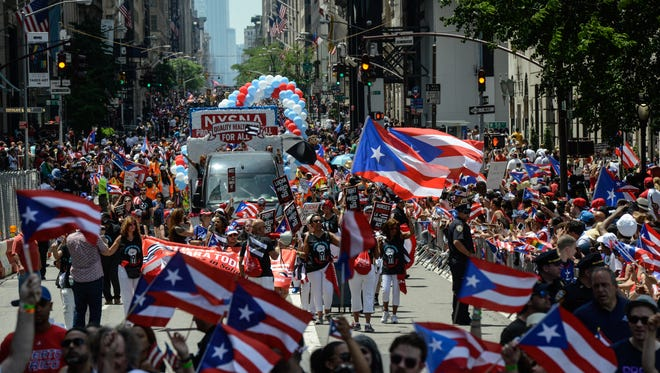 People participate in the annual Puerto Rican Day Parade, marching up Fifth Avenue on June 11, 2017, in New York.