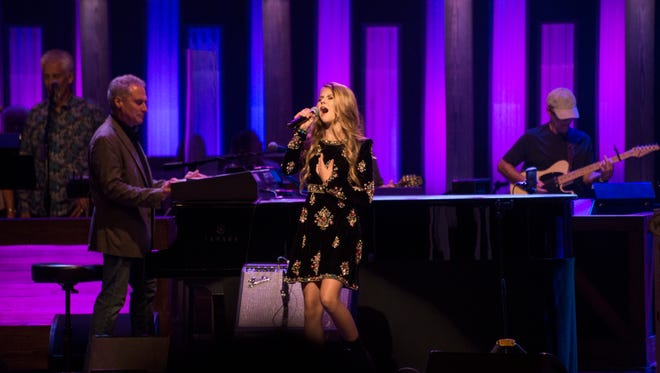 Tegan Marie, 13, debuts with two original songs at the Grand Ole Opry on Aug. 18, 2017. After signing with Warner Music Nashville earlier in the day she became the youngest country artist signed to the label and the youngest female in 45 years to sign a major label country record deal.