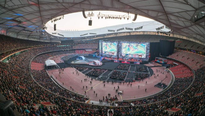 People watch the World Championships Final of League of Legends at the National Stadium 'Bird's Nest' in Beijing on November 4, 2017.
