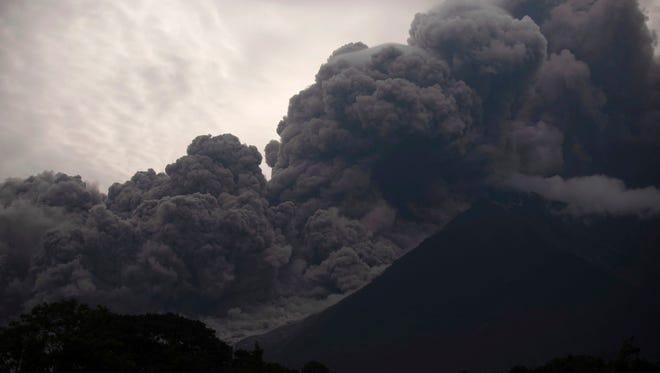 Volcan de Fuego, or Volcano of Fire, blows outs a thick cloud of ash, as seen from Alotenango, Guatemala, Sunday, June 3, 2018. One of Central America's most active volcanos erupted in fiery explosions of ash and molten rock Sunday, killing people and injuring many others while a towering cloud of smoke blanketed nearby villages in heavy ash.