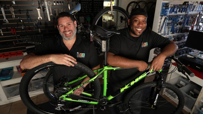 David Williams, left, and Arley Michel, co-owners of Just Riding Around (JRA), a bicycle sales and service shop in North Fort Myers, recently won the award for one of America's Best Bike Shops by the National Bicycle Dealers Association.