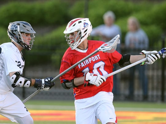 Fairport's Spencer Bell  (10) is defended by Pittsford's Shane Gaffney (32).