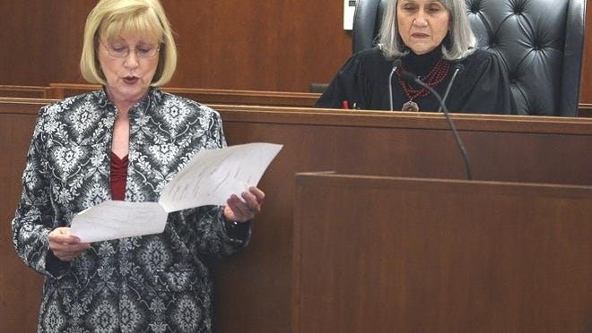 "As Chief Judge Nancy Parrish listens, Court Bailiff Norma Dunnaway reads the jury's verdict in the Dana Chandler murder trial in 2012. Parrish testified Wednesday during a disciplinary hearing for former Shawnee County prosecutor Jacqie Spradling that despite mistakes made during Chandler's trial, Spradling ""was trying to get it right."""