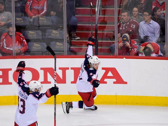 Columbus Blue Jackets left wing Artemi Panarin (9), of Russia, celebrates his game-winning goal with Cam Atkinson (13) during overtime in Game 1 of an NHL first-round hockey playoff series against the Washington Capitals, Thursday, April 12, 2018, in Washington. The Blue Jackets won 4-3. (AP Photo/Nick Wass)