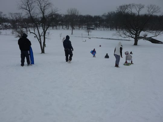 Despite gusts of cold wind during the afternoon on Thursday, families took to the slopes at Goffle Brook Park in Hawthorne to take advantage of the first big snowstorm of the new year.