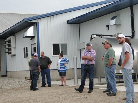 About seventy farmers from Dodge and Fond du lac Counties attended the Dodge-Fond du lac Forage Councils' annual twilight meeting, hosted by the Madigan family, Dodger Acres, at Rosendale.  The family offered tours of the farm, including their new robotic milking system, prior to the forage meeting.