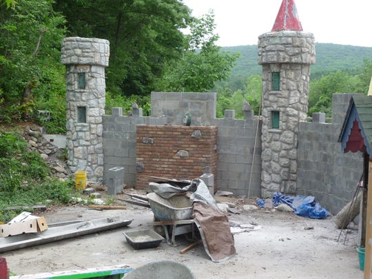 This June 18, 2012 photo shows the renovation of Fairy Tale Forest's front wall off Oak Ridge Road in West Milford, N.J., where Humpty Dumpty now again sits atop bricks.