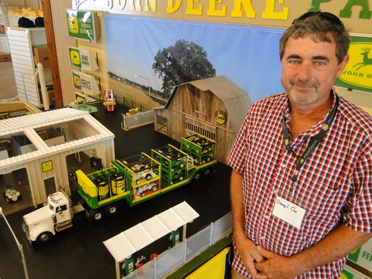 Toy Collector Darryl Cox, Humboldt, TN created a 1968 version of a John Deere lawn and garden tractor dealership including making a trailer for a semi-delivery truck with JD garden tractors loaded on it.
