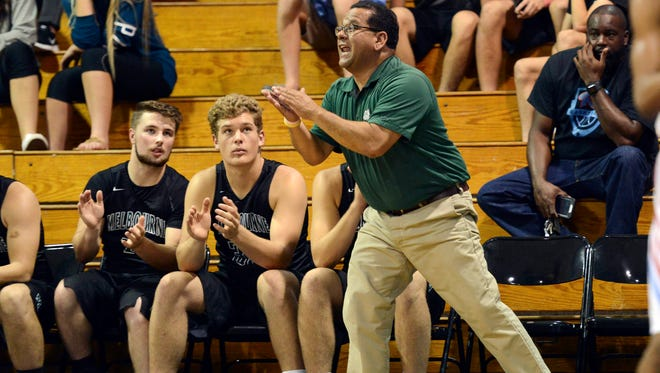 Melbourne boys basketball coach Michael Soliven directs his players during Thursday's finals of the Rockledge Kiwanis Holiday Classic.