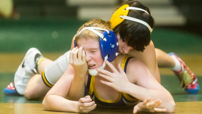 Indian River's Chris Wheeler (106-lb) squares off with Seaford's Richard Durham on Wednesday, January 13 at Indian River.