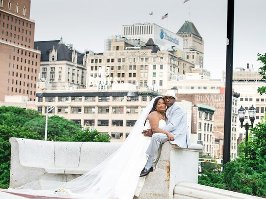 Marie-Danielle Attis and Greg Springs drew on Attis' deep ties to Rutgers-Newark for a second wedding ceremony and reception at the Paul Robeson Student Center in 2014.