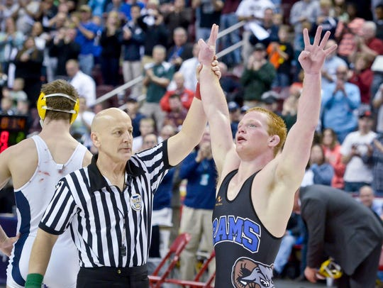 Chance Marsteller of Kennard Dale holds up four fingers