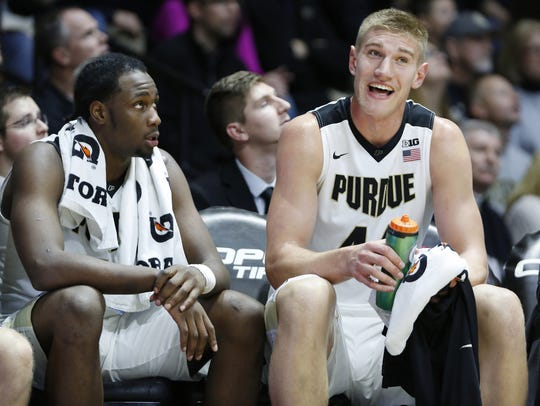 Caleb Swanigan and Isaac Haas have a laugh on the bench
