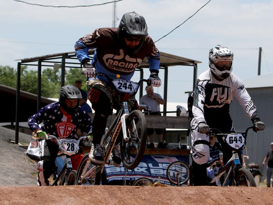 Riders take on the first hill on the second day of the USA BMX State Qualifier Sunday, June 11, 2017, at Wee-Chi-Tah BMX at 404 Burkburnett Road.