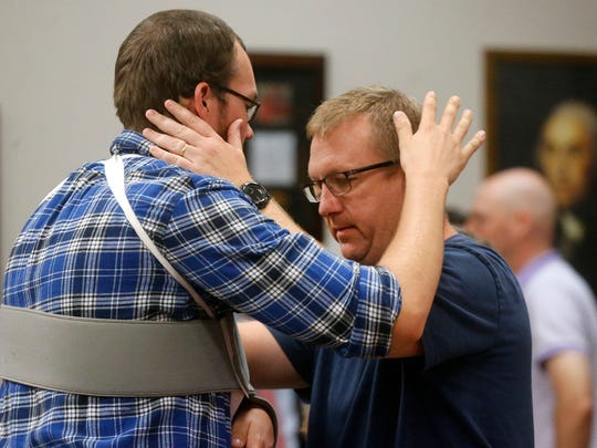 Richie Spann, right, the nephew of of Minister Joey Spann taks with Caleb Engle, left before a special ceremony at La Vergne City Hall Tuesday, Oct. 3, 2017,  where Engle was honored for his brave efforts at stopping a gunman at Burnette Chapel Church of Christ in Antioch, on Sunday Sept. 24, 2017.