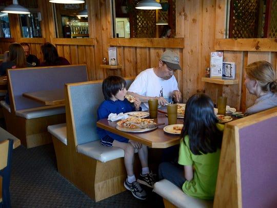 The Kawakami family has dinner at Cozzola's Pizza in
