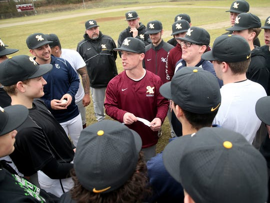 South Kitsap High School baseball team head coach Marcus Logue goes over the practice schedule to the team at Elton Goodwin Field at South Kitsap.