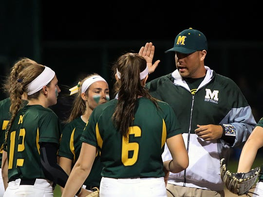 Montgomery coach Bryan Upshaw gets his team fired up during Friday's Somerset County final