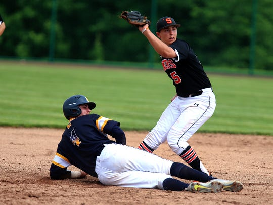 Colonia's Anthony Palmisano is safe at second as Somerville's Dan Belford applies the tag during the North 2 Group III sectional final on Friday, June 1, 2018.