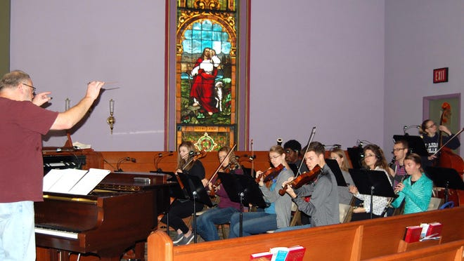 A rehearsal of a former Christmas concert at the Hillsdale First United Methodist Church shows community involvement that won't be possible this year as churches and schools have had to cancel holiday concerts due to the pandemic.