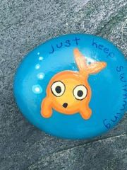 Rocks with encouraging messages painted on them are often hidden in public parks.