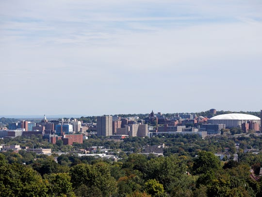 The Carrier Dome at Syracuse University, right, is