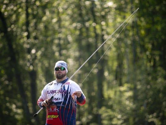 Auburn University's Tim Ward fishes on the Little Eau