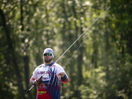 Auburn University's Tim Ward fishes on the Little Eau Pleine River during the Carhartt Bassmaster College Series National Championship on Thursday.