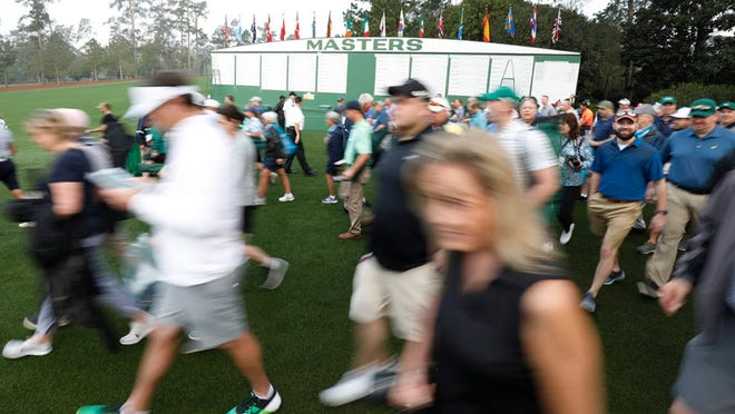 Patrons enter the course during the first practice round of the 2019 Masters Tournament. Only a limited number of patrons will be allowed into Augusta National this year, making Masters tickets more exclusive.