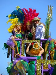 Krewe members get ready Sunday before the Krewe of