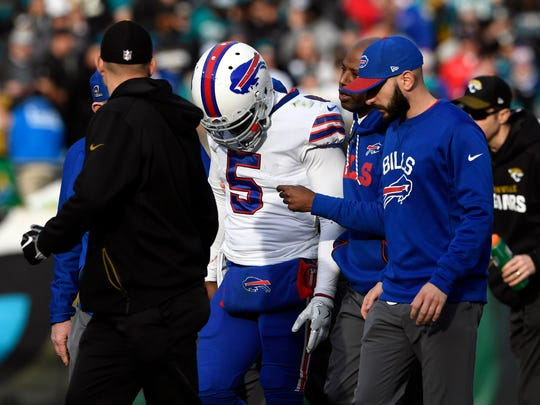 Jan 7, 2018; Jacksonville, FL, USA; Buffalo Bills quarterback Tyrod Taylor (5) walks off the field after being injured during the fourth quarter against the Jacksonville Jaguars in the AFC Wild Card playoff football game at EverBank Field. Mandatory Credit: Tommy Gilligan-USA TODAY Sports