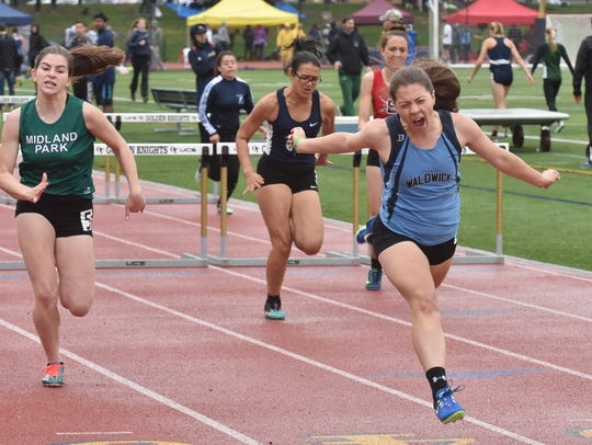 Kiara Zavala of Waldwick wins in 110m hurdles on the