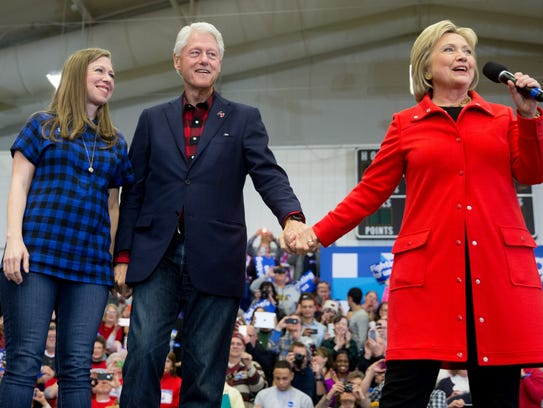 Hillary Clinton, accompanied by former president Bill
