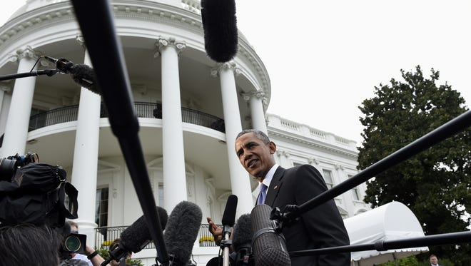 President Barack Obama speaks to reporters on the South Lawn of the White House in Washington, Sept. 29, 2015.