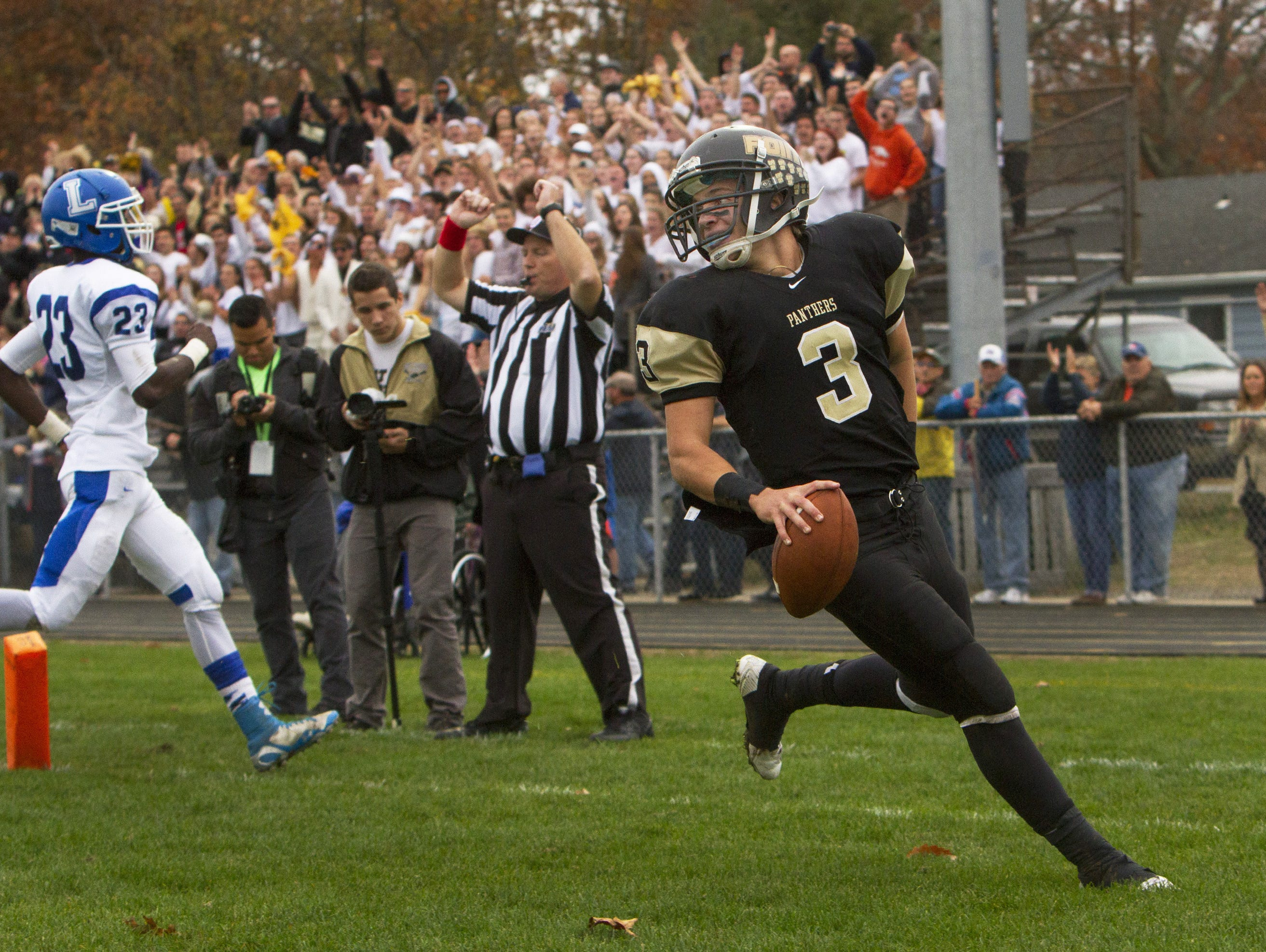 Point Boro quarterback Noah Husak, shown scoring a TD last week against Lakewood, will try and lead the Panthers to their second win of the season over Raritan Friday night.