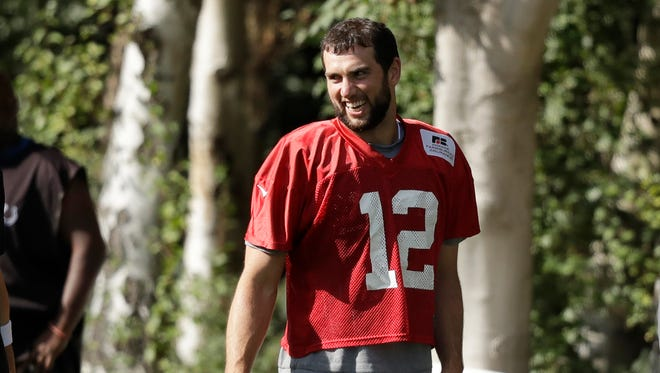 Indianapolis Colts quarterback Andrew Luck takes part in an NFL training session at the Grove Hotel in Chandler's Cross, England, Friday, Sept. 30, 2016. The Indianapolis Colts are due to play the Jacksonville Jaguars at Wembley stadium in London on Sunday in a regular season NFL game.