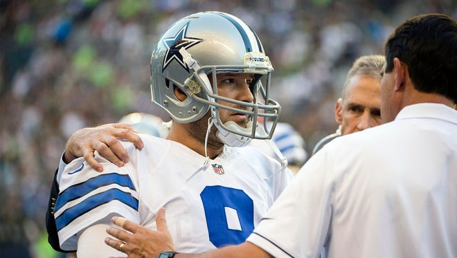 Aug 25, 2016; Seattle, WA, USA; Dallas Cowboys quarterback Tony Romo (9) is attended to after getting injured during the first quarter during a preseason game against the Seattle Seahawks at CenturyLink Field. Mandatory Credit: Troy Wayrynen-USA TODAY Sports