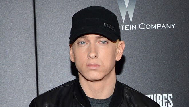 Rapper Eminem is shown in this 2015 file photo, without facial hair and not taking on President Donald Trump.