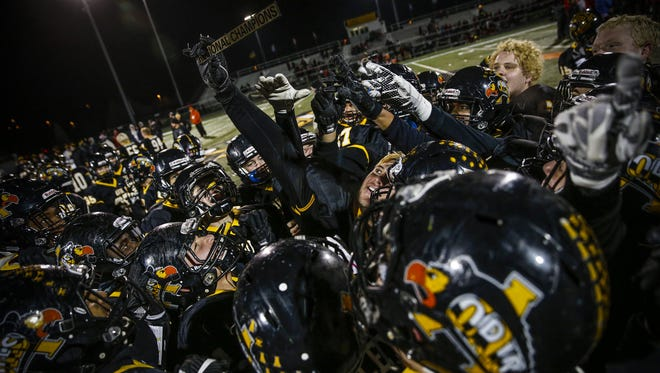 The Avon Orioles celebrate after defeating the Center Grove Trojans 32-31 in the IHSAA Class 6A regional championship at Avon High School on Friday, Nov. 10, 2017.