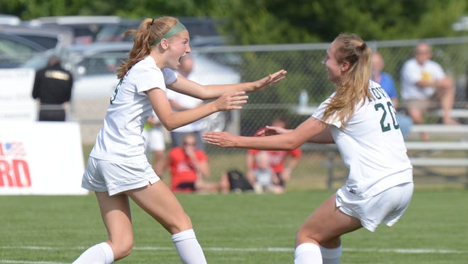 Novi's Avery Fenchel (left) celebrates her game-winning goal in the Div. 1 state championship game with teammate Julia Stadtherr.